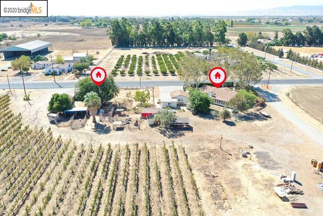 Located just East of Brentwood.  Two Homes. Barns. Class 1 soil Brentwood Clay Loam. Excellent soil for Cherries, Grapes, Almonds, Etc.  9+ acres planted to vineyard. Irrigation water from ECCID.  Seller has ordered Cherrie Trees for next year planting, buyer can move forward and plant orchard, at buyers costs. Ideal for U-Pick.  Has been farmed as organic farm for many years and is Certified Organic by CCOF.  Close to Knightsen.  Close to Delta for boating and fishing.