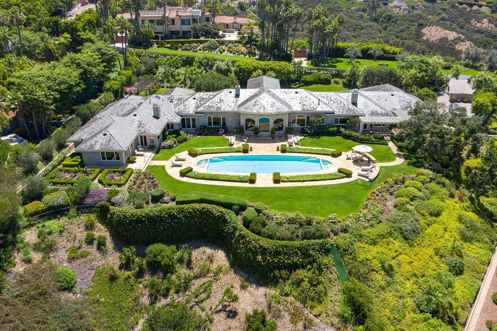 This custom built luxury estate was built by noted Architect Richard Salpietra and is located in the gated community of Del Rayo Estates.  The estate sits upon 1.68 acres overlooking the rolling hills of Rancho Santa Fe.  Located 4.5 miles from the beaches of Del Mar, this estate has breathtaking views that are anchored by the sparkling ocean to the west.  This 8,950 square foot estate offers the utmost in privacy.  There are 5 bedrooms that include two master suites, 5 full bathrooms with 4 half baths, a grand formal living room with 16 foot ceilings, an adjoining formal dining room, a gourmet kitchen with attached family dining room which opens to the pool and BBQ area.  You will additionally find a wood-paneled library, a study, an exercise room, a laundry room, maid's quarters, an attached four car garage with ample storage, and a salt water pool.  With sweeping views over the rolling coastal hills, manicured golf courses and private country clubs throughout Rancho Santa Fe, this estate is perfectly suited to enjoy breathtaking sunsets to the west over the sparkling Pacific Ocean.  This is a rare opportunity to own an estate-scale property in North County San Diego's most exclusive private community.