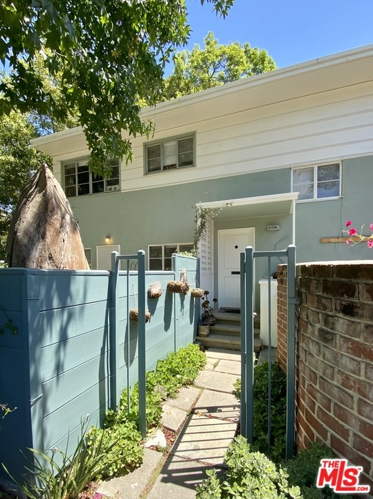 Fantastic opportunity to live inside 68 acres of green with more than 2,000 trees and less than a 20-minute drive to LAX, Beverly Hills, DTLA, and Santa Monica and within 2 miles from the Expo Line, Culver City, shopping, and restaurants. This upper corner unit offers 1 bed, 1 bath, 1 studio/office (or formal dining room,) plenty of storage space, original hardwood floors, and 951 SF filled with natural light from all 3 sides and views to tree tops and grassy areas. In addition, this tranquil unit includes a private patio on the entrance ground level and a private garage next to the community laundry area. Village Green is a National Historical Monument and Landmark located in Baldwin Hills that offers significant property tax cut through the Mills Act.