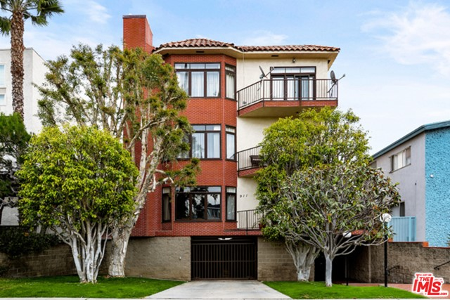 """Spacious, one-level condominium with no common walls,  5 blocks to Ocean Avenue. Tremendous light-filled unit with lofty ceilings, hardwood floors, recessed lighting, crown molding, both bedrooms with en-suite private bathroom, plus office/den, (or potential for a third bedroom). The primary bathroom has a separate shower, and jacuzzi tub, and a dry sauna room. Custom window blinds, fresh white kitchen cabinets with plenty of storage, and stainless-steel appliances. Move-in ready, in absolutely pristine condition. Security building with lobby, elevator, open patio off den/office, small community pool, and lounge area, earthquake ins., secured two car side by side parking, 6-unit intimate building. Stellar location, 5 blocks to the beach and 2 blocks to Montana Ave shopping/coffee houses/restaurants and more. Excellent school district. A true """"must see"""" unit to feel the abundant natural light, open floorplan, and high ceiling features of this unique home."""