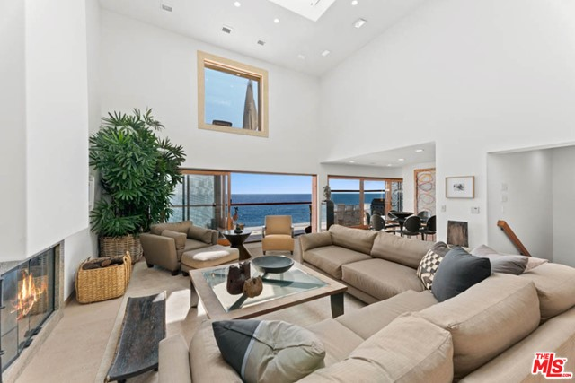 Welcome to this luxury coastal private & gated Residence situated on famous malibu road w/approx 50 ft of frontage overlooking the Queen's necklace, Catalina Island & Pt. Dume. Special features include but not limited to, approx. 1200 sq ft of ocean front decks, 4+ den/TV rm, a gracious courtyard w/grassy entry, stone floors, spacious dining room, light and bright 2 story living room w/skylite, fireplace, custom sliding glass doors w/screens opening to each level ,balconies w/glass teak railings. Plenty of wall space for displaying art, breakfast area w/custom built in cabinets, kitchen w/top of the line appliances. A Corner glass to glass window takes you to the top floor oceanfront master suite which offers separate  walk in closets, fireplace, built in custom bookshelves, Italian book-matched marble slabs in bath w/dual sinks, vanity, , tub w/jets, large glass shower, skylight, & dual water closets w/bidet.  2 car garage plus additional parking for guests, close to the Colony Plaza.