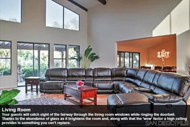 Your guests will catch sight of the fairway through the living room windows while ringing the doorbell. Thanks to theabundance of glass as it brightens the room and, along with that the 'wow' factor a high ceiling provides is something you can't replace.