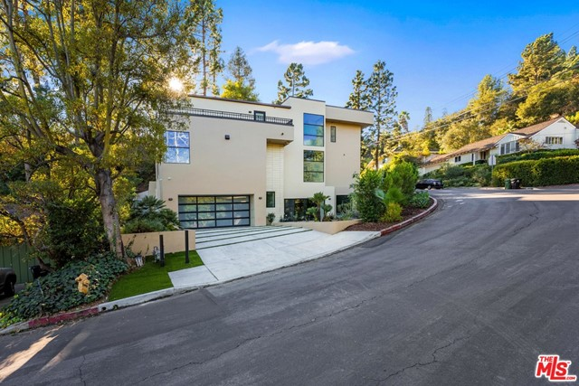 """Architectural Masterpiece in prime tucked away Brentwood neighborhood. Comprised of 3 levels all with open living spaces and fireplaces and direct access to the outdoors. Enter the house into a massive great room that contains an open gourmet chef's kitchen, stunning dinning area with """"wine wall display"""" living room with fireplace that flows to outdoor dining entertainment area. The top floor contains the Master Suite with spa bath. Two other bedroom suites and family room on top level. The lower level has an amazing bar, family room with fireplace and movie theatre plus 2 other bedroom suites (1 would make for an excellent home office). The incredible indoor/outdoor flow of this estate is perfect for entertaining yet comfortable and private for family living. Available early August, unfurnished."""
