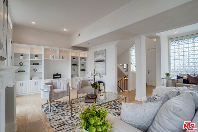$200,000 price reduction.  Don't miss this opportunity to live 1 block from the beach.  Welcome home to this beautiful 2bd 2.5 bath Penthouse.  A small 6 unit building sits close to Palisades Park, 3rd street Promenade and just one block from the beach. This stunning light filled unit is ideal for entertaining guests, enjoying dinner/drinks or relaxing with family and friends. There is an inviting rooftop with beautiful views of the ocean and mountains. Maple wood floors, skylights through out, high ceilings, fireplace, crown moldings, built-ins, plantation shutters and French doors to both balconies. The newly remodeled kitchen has granite counter tops with stainless steel appliances and custom Marmol Radziner designed cabinetry. Both bedrooms are located downstairs and are full suites. The master bath has been upgraded with a separate shower and tub. Comes with complete walk in closets and laundry in the hall.  Side by side secured parking, extra storage space and a guest spot.