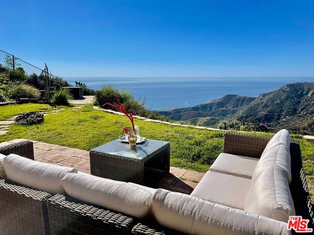 Experience your own private sanctuary at this enchanting Architectural enclave perched high on the hillside of the prestigious Sea View estates w/sweeping ocean and mountain views that will have you floating on Cloud 9! Offering a sublimely serene setting surrounded by nature, this dual-level is an entertainers dream w/highly-functional floor plan, full chefs kitchen w/top-notch appliances, well-appointed living quarters w/spa-like master bath, generously-sized closets, spacious bonus room/office, and even a beautiful backyard patio w/panoramic, 180-degree sea, sky and canyon views that offer the ultimate backdrop for outdoor entertaining at its very finest.Fire up the BBQ for dining alfresco and soak some of the most magical Malibu sunsets or spend sublime summer evenings roasting marshmallows under the stars. The sky's the limit and possibilities are endless at this fabulous find located just minutes from PCH w/prime location near award-winning dining, shopping and hiking trails.