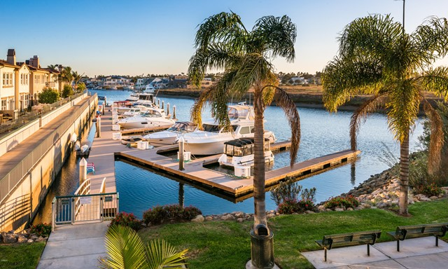 Unobstructed water views & across sand dunes to the islands the southern exposure is ideal.  Love the harbor & beach breezes. Steps off your terrace is your 60ft boat slip for your yacht, fishing boat, & paddle toys. This luxury home is custom ground-up rebuilt over two years by artisans finished in 2009. Spectacular 3-Bedroom en-suite, 6 bath home has an amazing ELEVATOR & circular staircase.  Kitchen & bar seats 20+ & chef's delight with bespoke cabinetry, hand-carved teak accents, 48'' gas Wolf cooktop, 2 ovens, 2 refrigerators, walk in pantry & laundry. Whole house warm floors, soft water system and drinking water purification.  2 air conditioners. 2 offices & built-in storage. Custom ceilings of hand applied silverleaf, silk, sisal, & custom carved teak. Enjoy Master Suite sunset views. Extensive use of natural stone in & out, one-of-a-kind custom glass windows. The most beautiful, custom harbor-front home you've ever seen'' is just south of Santa Barbara & 1 hour north of Malibu.