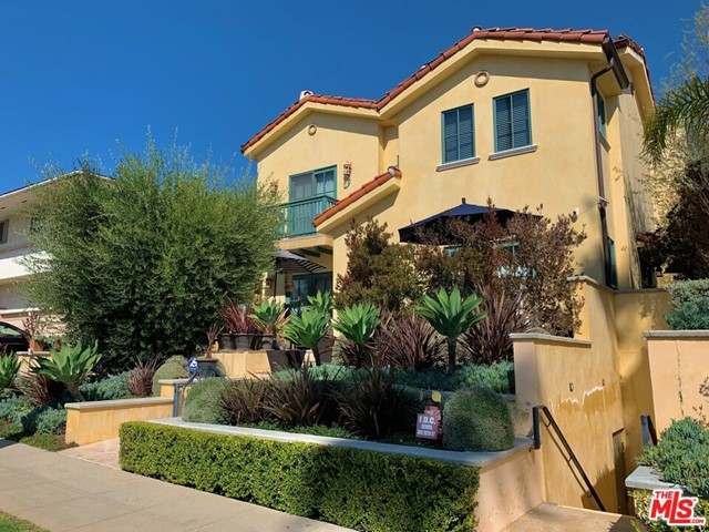 This exquisite Mediterranean 3 bed+2.5bath townhouse boasts an elegant open floor plan w/ a large formal living room, dining room, beautifully refinished wood floors, fireplace, surround sound system, and vaulted ceilings. French doors leading to a large garden patio, with newly tiled floors and custom built-in patio seating.  Open style gourmet kitchen features top-of-the-line appliances, granite countertops, lots of storage, and a breakfast bar area. Balcony in the primary bedroom and also in the second bedroom, where you can enjoy the beautiful landscape and palm tree views. Primary bedroom has fireplace high ceilings and a walk-in closet.  Entertain in the lovely rooftop deck and savor the views of the city, palm trees and even a little bit of the ocean.  Complete with private two car garage with direct access to unit.  Located just minutes from Montana Avenue shops and restaurants,.