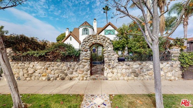 Step behind the enchanting stone walls for a one of a kind private artists enclave in prime Venice Beach location. The home has many details lovingly added by the current owner over the past 23 years. Artisan touches such as hand made tiles, stained glass windows, infinity ceiling, rounded walls, & original detailing are just a few of the details that add to the bohemian charm this property offers. Originally a single-family home now a duplex with a large studio unit upstairs (1458 +/- SF) & a 3-bedroom, 1-bathroom unit downstairs (1920 +/- SF). Two outdoor entertaining spaces, the oversized covered patio or upstairs deck & private backyard, enjoy the ocean breeze.  There is a two car garage along with extra storage room.  Wonderful investment opportunity as-is or an ideal project for an owner-user who would like to live the Venice Beach lifestyle close to the beach and make it their own. Potential to turn back into a single family home with a master suite upstairs.