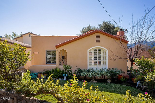 Exquisite and meticulously updated 1926 Spanish style home with an abundance of character and curb appeal. Located above Foothill Blvd, this unique dwelling is in close proximity to Monte Vista Elementary School, Rosemont Middle School, Crescenta Valley High School and Two Strike Park. The charming Spanish architecture can be felt throughout the home from the large colonial arched window that brightens up the living room, to the hardwood flooring, a cozy fireplace setting, plantation shutters and trayed plastered ceilings.  The eat in kitchen has been tastefully remodeled with custom white cabinetry, white quartz countertops, Spanish tile flooring, trayed ceiling and stainless-steel appliances.  The long paving stone driveway leads to a two car plus detached garage and entertainer's backyard. The beautiful lush green grassy backyard with fruit trees has lovely views of the majestic Verdugo Mountains and is perfect for outdoor dining. Some other nice features of this home include: Newer dual pane windows, updated electrical, copper plumbing, a remodeled bathroom, and heavy duty glass screen doors that let in an abundance of light. This home is move in ready!