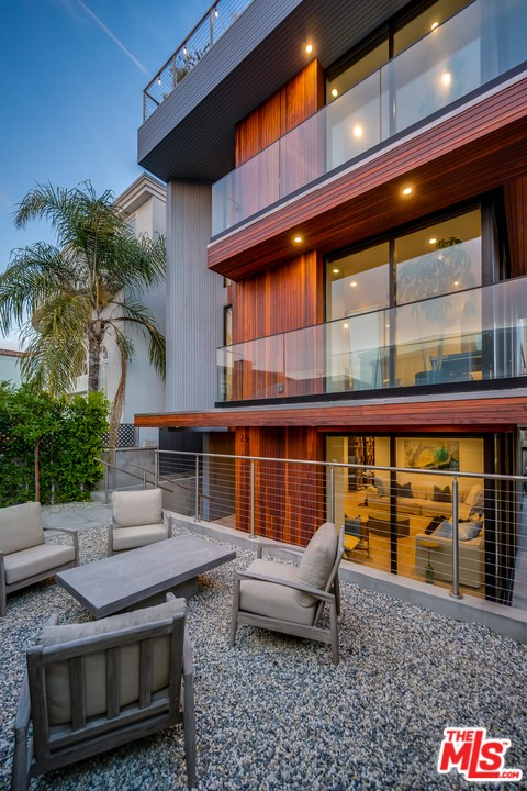 Stunning Architectural Beach Home built in 2017 on a lovely walk street only steps to the sand. Incredible light and high ceilings throughout with 4 bedrooms all en-suite, powder room, media room, den + nearly 2,000 square foot rooftop deck with 360 views from Catalina to Malibu + an elevator that goes to all levels. The grand room boasts a spacious living room and den with a chef's kitchen in the middle - customized with sea pearl quartzite counters, walnut cabinetry, Miele appliances and built in kitchen table. The living room sliders go into the wall as a pocket so the room feels as though you are outside with incredible ocean breezes.  The master suite is facing the walk street with an enormous walk-in closet & gorgeous spa like bathroom. This home is thoughtfully designed with very private comfortable spaces and large open community spaces. Walking distance to many shops, restaurants, the canals and Abbott Kinney. Can be purchased with all furnishings included.