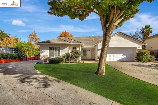 Rare find! One-story at the end of a court with RV/Boat parking! Extended driveway in front of home, in front of RV/Boat parking and behind the gate.  Pristine interior!  Gleaming wood floors in deep, rich color.  Two-tone interior paint in neutral color.  Cozy two-sided fireplace between family and living rooms. Dishwasher recently replaced.  HVAC system replaced in 2019. Recirculating hot water system means hot water faster! Lovely plantation shutters.  Seller spent $3,600 on gutter filter to help keep leaves out.  Large tool shed stays.