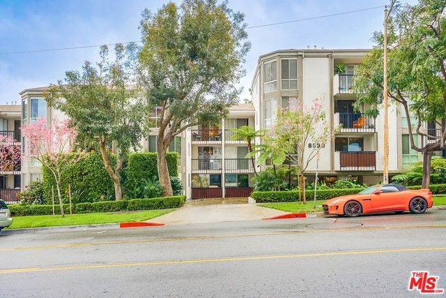 Resort style living in one of the most desirable WeHo nbhds. Magnificent top FL 2 BD & 2 bathroom unit located steps from elevator. Open concept creates entertainer's flow. Spacious LR w/cozy FP & slider leads to private balcony & view of HHills. DA open to updated kitchen w/2 stool counter bar for your morning coffee blend. MA BD w/romantic night views of the city has 2 large closets & MA BA w/dual sinks & xtra large vanities. 2nd BD opposite side of unit provides privacy for roommates. FL to ceiling Milgard double-paned windows w/dual panel shades thruout. Addtil amenities include: recessed lighting, engineered HDWD floors, solid core doors for bedrooms & SxS parking conveniently located near bldg entrance. Resort style amenities include heated pool, sauna, gym, rec room w/pool table & kitchen, & rooftop deck w/360 degree views. Minutes from off-leash dog park & all the best boutique fitness studios, gyms, grocery stores, bars & restaurants WeHo has to offer!