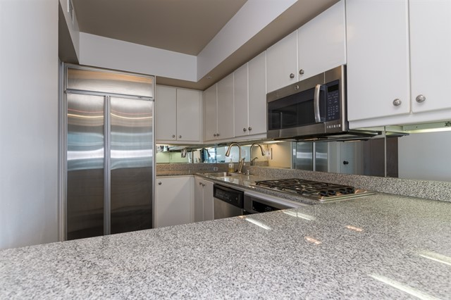 Stainless appliances include a Sub-Zero fridge.