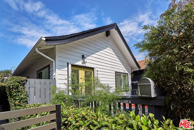 Darling Ocean Park 2BR/1BA bungalow on Navy Street located in breezy Santa Monica. Light and bright main living and dining areas feature high vaulted ceilings, skylight, brand new flooring, and a superb bonus loft area perfect for guest room, office, or playroom. Chef's kitchen features stainless steel appliances, quartz counters, and excellent storage space. Two spacious bedrooms, each with their own designated closets, plus a generous full bathroom complete the floorplan. The sizable front sun deck is gated and hedged for privacy, as is the lovely backyard oasis, boasting another large deck and pergola, custom built-in bench seating, and firepit. Uncovered parking in the rear via alley access. Just a short stroll to Marine Park, Groundwork Coffee, Cafe Gratitude, and Whole Foods. Minutes from the beach, Santa Monica Pier, and all that Main Street and Abbot Kinney have to offer including a fantastic Sunday Farmers Market and award-winning dining. Your commute to the metro here is easy too  you can truly leave the car at home and enjoy the beach-style living you've been dreaming about. Santa Monica is one of the most sought-after neighborhoods in all of Los Angeles, and this Ocean Park paradise is overflowing with positive coastal California vibes. A sheer delight!