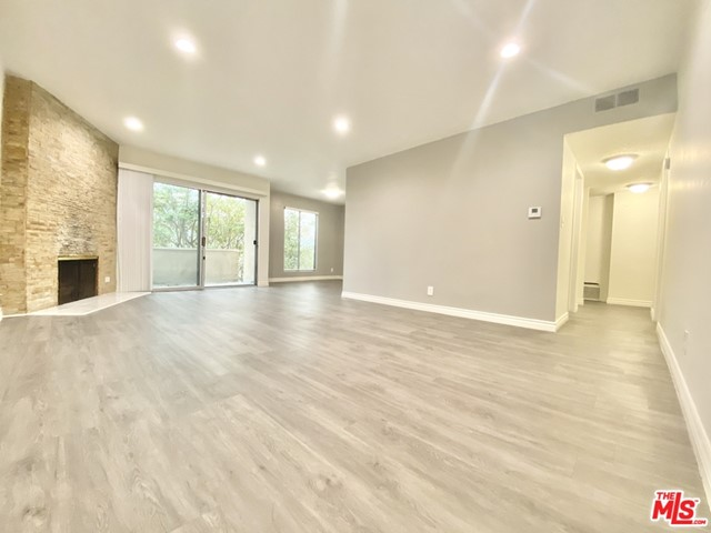 **EXTRA-SPACIOUS, FULLY RENOVATED UPPER UNIT 3+2 IN PRIME LOCATION AND ONLY 1500 DEPOSIT OAC**Excellent location within walking distance to dining, shopping and businesses and just minutes from the NOHO Arts, theatre and entertainment district, Metro red line, NBC/Universal and other major studios. This is a fully remodeled luxury unit with high quality finishes featuring:Spacious Living Room with Recessed LightingBrand New Kitchen with Stainless Appliances Including Built-In Microwave, Dishwasher & StoveBrand New Shaker-Style White CabinetryGrey Quartz Counter TopsBeautiful Stone FireplaceSpacious BalconyNewly Painted Throughout with Designer Accent WallsWood-Like Flooring ThroughoutNew Freestanding Bathroom VanitiesCentral A/C & HeatUnit Overlooks Newly Landscaped Park-Like Courtyard with FountainControlled Access Building EntryGated Parking with 1 Tandem Spot IncludedAnd much more...