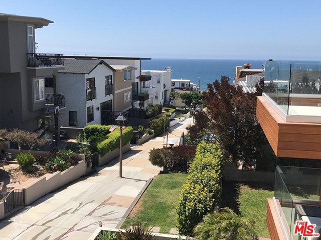 OCEAN Views. Great location on one of the best walk street's, in MHB. Front home with every room completely remodeled . Kit with all Thermador Stainless all appliances. Six-burner Thermador with blue knobs, Custom Granite counter, no seems, breakfast bar, large white Allia sink, two pantries with sliding glass barn doors. Hardwood floors throughout, Custom wood shutters, Large very bright open floor plan, high ceilings, dining room living room ocean views. Downstairs bedroom with walk in en-suite bathroom, ceiling fan, walk-in closet, with chandelier. The upstairs bedrooms, studio/office, deck off master. Bathroom has quartz custom counter with dual sinks, all of these rooms can be closed off, with a barn door which can create a suite. Vaulted ceilings. And then we have wonderful loft with ocean views and a balcony. The back unit is not attached to main house and is a blank canvas.