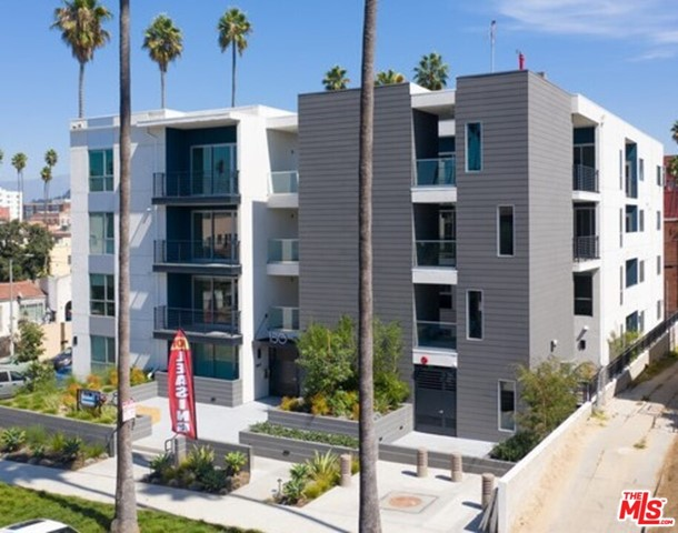MAJOR PRICE REDUCTION!!! Built in 2019, 150 N. Berendo offers a mix of designer 1 Bedroom + 1 Bath units, 2 Bedroom + 1 Bath units, 2 Bedroom + 2 Bath units and 3 Bedroom + 2 Bath units along with numerous common area amenities. Exquisite modern architecture with over 25,000 square feet of building space and unit amenities such as Modern Custom Kitchens with Stainless Steel Appliances, In-Unit Washer/Dryer, Smart Home Technology, Modern Hardwood Floors, Central A/C & Heat, and Patios/Decks. Common area amenities include: Outdoor Courtyard with BBQ, Community Room/Co-Working Space, Fitness Center, Amazon Lockers for Deliveries, Security Access, Covered Gated Security Parking.