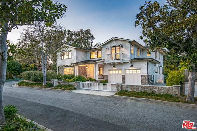 Exclusively located on a private cul-de-sac in Santa Monica. This expertly crafted & newly constructed estate is the epitome of luxury living. Situated on a large 12,190sqft lot provides privacy, an expansive grassy backyard, a gorgeous pool, BBQ, sunken fire-pit & perfect entertaining spaces. This Traditional home is over 8,400sqft of well-proportioned & generously sized rooms. Designer finishes & premium, hand-selected stone, marble & tile thru-out. Reclaimed European White Oak floors. Large kitchen with double islands & the latest top-of-line appliances. Five bedrooms upstairs including master retreat with private office, fireplace, balconies & huge windows allowing sunset views. Lower level features a large gym with cedar sauna, steam shower & Pavigym flooring, tiered theater, modern wine cellar with mahogany shelving, guest suite, large family & game room. Fully gated with security & camera system. This new private compound is rare and exquisite.
