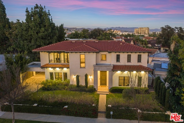 Newly constructed in 2015, this extraordinary modern-Mediterranean residence showcases masterful craftsmanship, blending timeless sophistication with contemporary design. Situated over an expansive 4,586 sqft, the first floor boasts a 2-story foyer, formal living room, dining room and a large chef's kitchen with top of the line appliances. An indoor-outdoor floor plan offers multiple sets of French doors that lead out to a lush, landscaped backyard complete with heated pool, spa, fireplace, outdoor kitchen, and a large, separate guest house with private exterior entrance. Upstairs, 4 en-suite bedrooms await including a master suite with his/hers dressing rooms and an exquisite master bath with high pressure steam shower. Located north of Wilshire in the heart of Beverly Hills' Platinum Triangle, the best of Beverly Hills shopping and dining is wonderfully walkable, offering the best of the City at your doorstep!