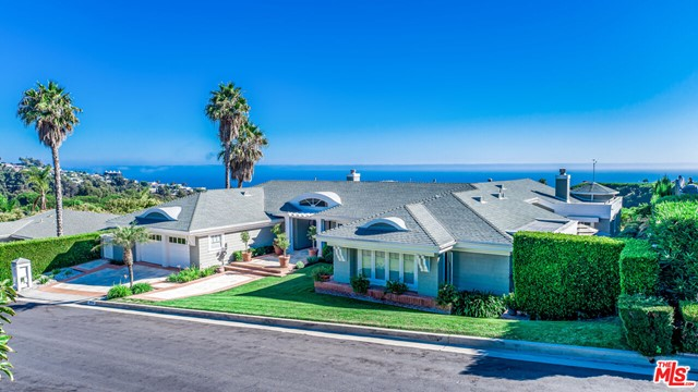 Unquestionably, one of the best view lots in the highly-coveted Surfview Estates neighborhood.  Move right in, or use your creativity to re-imagine this unique estate site.  With 3 bedrooms and 3 bathrooms, and over 4,900 square feet, this home is big-boned, and situated on a prime, expansive ocean view lot. The possibilities abound. Centrally located within easy reach of Malibu, Pacific Palisades and Santa Monica.