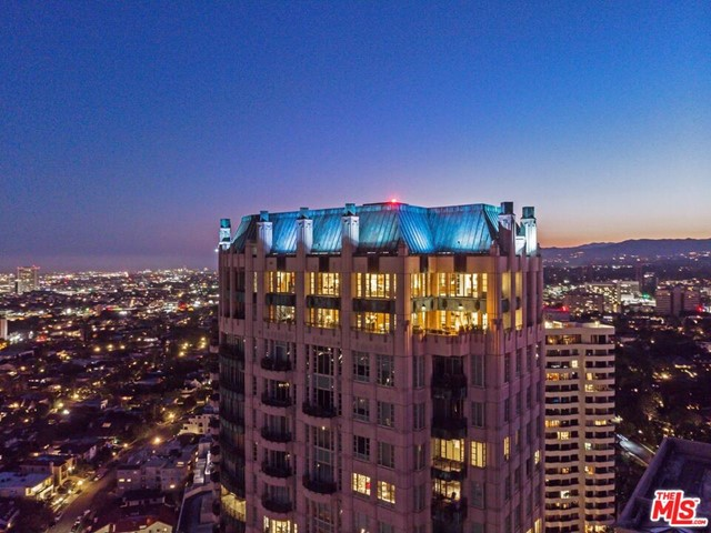 The premiere unit in the most prestigious building on the Corridor.  The fully-automated Presidential Penthouse at The Wilshire offers the unprecedented quality & luxury of a 2-year project designed as a forever home w/extreme attention to detail & no expense spared, w/high ceilings & clean, warm, modern finishes. 2-story art gallery & unobstructed views high above LA. Wine wall, living room opens to indoor/outdoor dining rooms lit by the city. Eat-in kitchen w/Sub Zero & Wolf appliances + guest-suite. Private elevator to Master w/auto blackout shades & walls of glass. Private gym, office, walk-in closets & spa-like baths. 5-star amenities; 24 hour concierge & valet, pool & fitness center, wine locker, storage & private meeting rooms, commercial catering kitchen & 4 parking spaces. Just blocks from the ever-green Comstock Park, Hammer Museum, Geffen Playhouse, UCLA medical center, dining & shopping. East coast sophistication meets a modernized west coast luxury lifestyle.