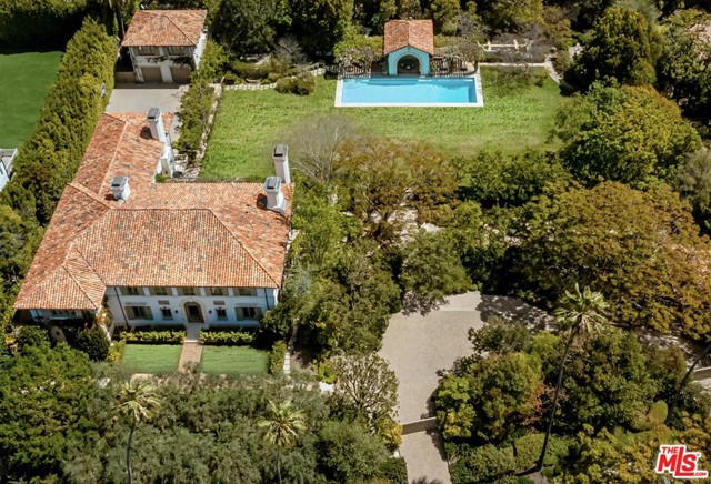 ONE OF THE LARGEST SINGLE ESTATES IN BRENTWOOD PARK FT APPROX 57,073 SQ FT LOT! A breathtaking Mediterranean Estate created by renowned architect Oscar Shamamian & collaboratively designed w/ Michael Smith. Romantic Villa w/ 3 stories, 7 beds, 11 baths, resides on an expansive lot. The interior of the home is airy & light, curated w/ impeccable architectural details & finishes sourced from all over the world. Each of the sun-drenched first floor rooms leads to the home's tranquil Mediterranean gardens, enormous grassy lawns, serene patio areas, pool, jacuzzi, cold plunge, & sauna. Take a stroll through one of the estate's bucolic walking paths under the moon & stars. Your guests will relax into their own private guest house. Perfectly placed in the heart of Brentwood Park, this Rare Estate close to the Brentwood Mart is a HOME that warms the heart and captivates the soul.