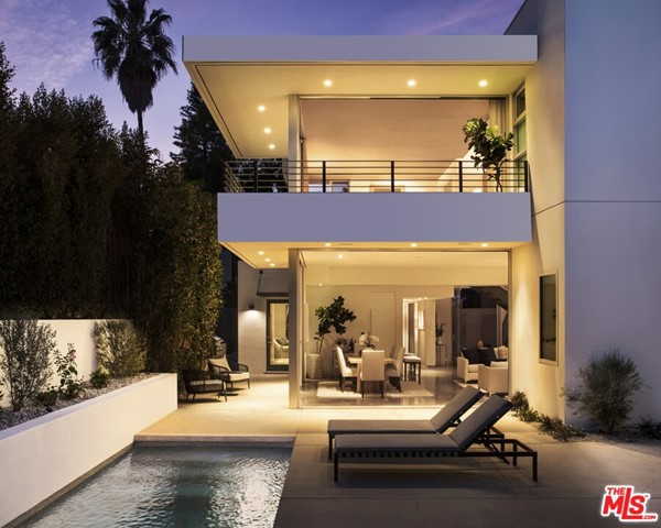 Located on arguably the most exclusive street in all of Venice, this architectural home is a three bed, three and a half bath stunner with a modern pool and privacy. The clean, crisp open-plan interior complements the rectangular cantilevered exterior while multiple 26 feet Fleetwood sliding pocket doors celebrate an abundance of natural light throughout. Large living and dining room create an elegant ambiance with polished concrete floors, fireplace and seamless indoor/outdoor entertaining through the oversized glass sliding doors. The spacious backyard exudes privacy with a loft-style pool house, pool, and BBQ. Modern eat-in kitchen with breakfast bar boasts quartz countertops, high-end stainless steel appliances and beamed tongue and groove vaulted ceiling. The expansive 900 SF master suite takes up the entire second floor and features vaulted ceilings, backyard views and a spa-like master bathroom with dual sink vanity, and custom walnut closets.