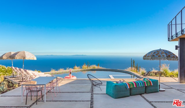 Extremely rare and gated, custom modern home on top of one of the highest designated ridge-lines in Malibu with spectacular, unobstructed views around the entire property.  180 degrees ocean view to the west and 180 degrees mountain view to the east.  This Malibu gem was consciously crafted with a focus on design-forwardness and livability while providing ultimate privacy and exclusivity.  Pool + Spa + 3-car garage & RV/Boat Carport complete this private modernist estate.