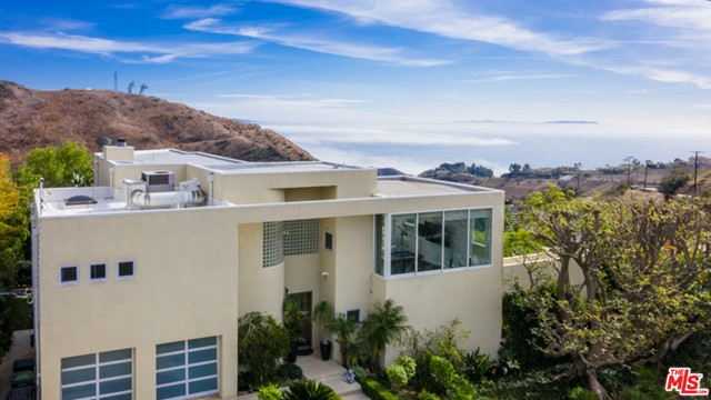 Light and bright 4 bedroom, 4 bath architectural ocean view home. Beautiful hardwood floors,high ceilings, upgraded kitchen and baths. Incredible living room with fireplace and stunning expansive ocean views. Large bonus/game room and 2 car garage. Sundrenched patios and decks that look out over landscaped yard. Enjoy the best of Malibu from this great family home.