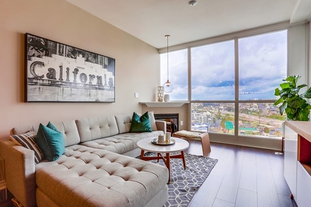 "HYPNOTIC VIEWS! Prime location within Little Italy & walkable to San Diego's hottest food scene & famous ""Mercato"" farmer's market. This bright, move-in ready home features designer paint & lighting + updated laminate flooring in master bedroom & living area. Custom, California Closets in master! Kitchen boasts modern stainless appliances, upgraded fixtures, full-size stackable washer & dryer + STORAGE area. LOW HOA dues + remodeled pool/spa area w/sun deck, recreation area, pool table & fitness center. Neighborhoods: Little Italy Complex Features: ,,,,,,,, Equipment:  Dryer,Pool/Spa/Equipment, Range/Oven, Washer Other Fees: 0 Sewer:  Sewer Connected Topography: LL"