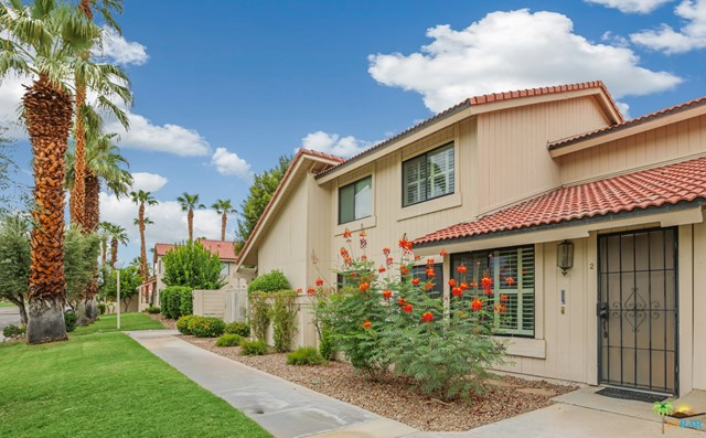 Updated, Furnished, 3B/2.5B townhouse condo at Mountain Shadows in Palm Springs, located on Fee land you own. Unobstructed western views of mountain and golf course. Private, sunny eastern patio connects to the assigned carport space and kitchen/dining area. HVAC installed in 2018, thermal double pane windows. Kitchen has been thoughtfully modernized with quartz countertops, fixed peninsula prep area, premium appliances and completely replaced cabinetry. Vaulted ceilings in the living room, plantation shutters, ground floor den could be used as an office or bedroom, and powder room has been recently updated. Concealed indoor laundry area. Authentic hardwood floors throughout. Expansive owners suite with en-suite bathroom. Mountain Shadows is a gated resort-style community with mature citrus trees, six pools, tennis courts, pavilion and lush green spaces and landscaping. Low HOA dues with minimal restrictions on vacation rentals. Close proximity to golf, hiking, dining and shopping.