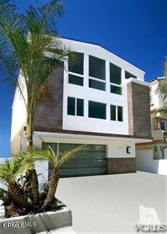 This ocean front 3 story~4 bedroom/4 bathroom with apprx. 3800+ sq. ft. is definitely worth seeing!!  First level offers 2 bedrooms, both with views of the beach, a full bathroom and a 2 car garage.  The second floor main level of this property features the kitchen, dining area, living room and a half bath.  Kitchen has imported granite, travertine and Viking appliances.  The living area with gas fireplace boasts a beautiful 180 degree view of the beach!  The third floor level of this estate features 2 more bedrooms, including the master.  Both bedrooms have their own full bathrooms.   Master bedroom has a private balcony, 180 degree views of the ocean, a fireplace and a large walk in closet.  Master bath features custom stone shower, large oval tub and his and her vanities.   Bring your furniture and beach toys and enjoy  endless summers!!