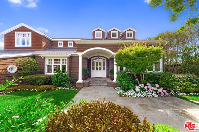 Located on Pt. Dume's MOST sought after street, this magnificent custom-built Hamptons-style compound sits on a flat 1.4 acres!  Only 3 houses away from Riviera 1 BEACH gate's card-coded access to Zumirez's own drive-a-car or walk-to-the-sand exclusive beach.  Tucked behind gates with rolling lawns & lush landscaping, tree-filled, Wisteria laden park-like grounds, this compound features a gorgeous sun-filled main house with a wonderful floorplan perfect for entertaining & comfortable living.  Huge outside covered entertaining patio with massive fireplace begs for gatherings all year long.   Inside, antique Walnut floors & wood plank walls adorn the home, fusing East Coast elegance with Malibu living.  The home has a seamless indoor/outdoor flow, paying homage to the natural beauty which surrounds this immaculate residence. There are 4 bedrooms, office, den  large work-out room with extra storage inside main residence & 3 car garage along with massive GH above it.  Also for summer lease @ $100,000/mo August, September. Yearly lease $70,000/mo Don't miss this property!