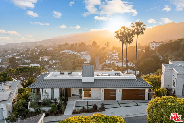 This contemporary home has breathtaking sweeping views from the ocean to the city. Each and every detail was considered in this new build in its prestigious ocean-side neighborhood. High ceilings, open floor plan, and sliding Fleetwood glass doors are just some of the stunning details that complete this home. Light shines through perfectly making happy and bright living spaces and bedrooms. The 7,800 sq/ft spacious home has six en-suite bedrooms and eight bathrooms, perfect to host guests. The main suite has a fireplace and balcony, a perfect retreat to sit back and relax. Enjoy the luxurious amenities of the theater, rooftop deck, 3 car garage, and elevator. The private pool, spa, and built-in BBQ, wine cellar and full onyx bar make this home a destination for entertaining friends and family. Dont miss your opportunity to own this incredible home.