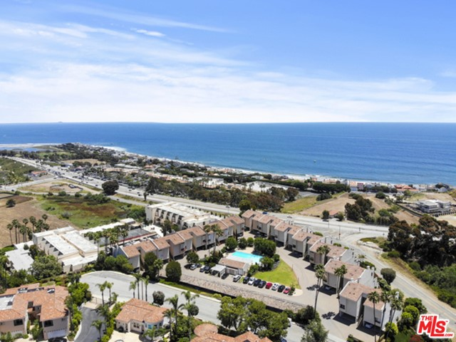 Dont miss this opportunity to own a highly desirable condo located in the heart of Malibu. Wonderful 2 story floor plan. Consists of 1 large master bedroom downstairs that opens up to a private outdoor patio. Kitchen, living area & 2nd full bathroom on entry level. Owner has installed a partition and door creating 2nd bedroom/office on entry level. Top/entry level includes a very spacious balcony with peek-a-boo ocean views. Lush grounds & an incredible pool area. Complex is located by Pepperdine University, with great shops and restaurants such as Whole Foods, Malibu Country Mart, & many More! Perfect for Pepperdine student and or future investment!