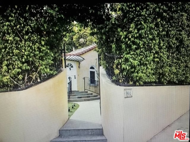 Charming and renovated Duplex located on a corner lot in WeHO. Formerly owned by legendary actress, Faye Dunaway, sits this gem with 2 detached units hedged for security and privacy, each with separate gated entrances and plenty of outdoor areas for entertaining. Bright unit with French doors leading outside to its patio. Vacant unit for rent has 2BD/2BA and fireplaces in the living room and Master, which includes large walk-in closet and bath with His and Hers sinks. This stunning duplex property was previously renovated from TOP TO BOTTOM while maintaining its character & charm. Intricate crown moldings and classic arched doorways and windows pair perfectly with the stunning Contemporary light fixtures, beautiful hardwood floors, and kitchen/bathrooms. The main unit is 1474 sq. ft. with an enclosed garage and large private front yard. Only the MAIN house is available for lease.