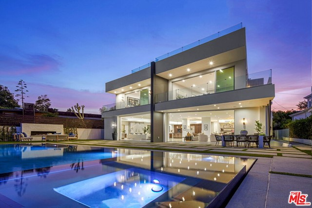 This stunning brand-new construction with ocean views is a California modern masterpiece in the heart of the Pacific Palisades! This gem is masterfully designed with natural light throughout the home and an abundance of outdoor living space. The home truly represents the quintessential California lifestyle. Notable design features include vaulted ceilings, skylights, rooftop deck, lower level with wine cellar, bar, screening room and an elevator.  The home boasts an incredible master suite complete with a spacious bathroom including dual toilets, dual walk-in closets, and pocket doors that open up to your own balcony.  Outside enjoy a private retreat with a pool, spa, BBQ and outdoor dining area, while enjoying the spectacular ocean view and the soon to be lavish George Wolfberg Park (at Potrero Canyon).