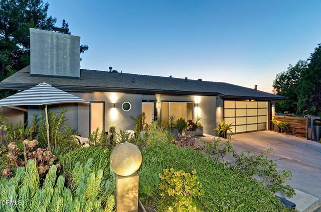 Located in the desirable San Rafael Hills, this peaceful two-story Mid-Century has the tranquility of a tree house. Floating high among the treetops with spectacular views, one feels far removed from the stress and noise of city life. Sunset skies and city lights are on display at twilight. With its clean lines and light-filled open floor plan, this spacious 3BR/3BA home is a rare find that provides all the comfort and amenities of a single-family house, but with low maintenance ease--for those who prefer their own lush private yard, vegetable garden or green yoga area, they can easily add a few stairs and fence in the wilderness beneath (as some do in this neighborhood) and enjoy the outdoor Zen. Kitchen/baths tastefully remodeled; many other upgrades include new HVAC, new roof and updated electric and plumbing systems. Wood floors throughout, recessed lighting, newer dual-paned windows and sliding glass doors & more. Whether you're looking to downsize to something easy or move into a mid-century view home in the hills, this house is perfect for you. Convenient access to DTLA, Burbank & Los Feliz, and minutes to the 110, 2 & 134 Fwys. Fully renovated and professionally decorated, this house is truly a turnkey gem.