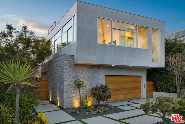 Located in the heart of Santa Monica just minutes from Main Street and Venice Beach, this incredibly well positioned modern architectural home is the beach living escape you've been waiting for. As you walk through the private gate you're immediately drawn to the immaculate landscape, massive sliding glass doors and uniquely designed architecture. This is the perfect residence for entertaining friends and family. Fully loaded with a summer kitchen and true chefs kitchen, you're able to easily entertain both indoor and outdoor guests simultaneously. Enter the second level and benefit from all the natural light Los Angeles has to offer. This home office is the absolute best work from home scenario you could imagine with clear views of the Santa Monica mountains. Each of the four bedrooms and hallways have massive windows taking advantage of all the light. Finally, enjoy your rooftop living space that include the Net Zero solar panels. Do not miss out on this opportunity!