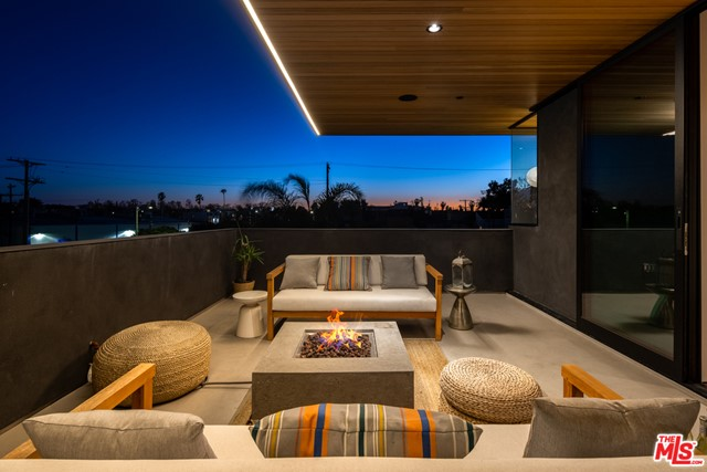 One of a kind custom architectural masterpiece with the beach in your backyard! Step into this soulful home with its own legal 2nd unit/studio! Designed by Robert Thibodeau, this home was completed with the utmost attention to detail. Indulge in every detail as you enter into the main level with soaring windows running the length of the second story, a fabulous chef's kitchen, and meticulously crafted hardware and lighting. You will find admiration in the soaring cedar ceilings, Ann Sacks tile-work, the solid oak herringbone hardwood floors, and Portola Roman Clay Gypsum walls that guide you to the second story while taking in all the artistic details. Upstairs you will be drawn to two spacious bedrooms and a loft/den perfect for your home office! An expansive, luxurious master retreat that encompasses the entire third floor with a cedar sauna and deck with views. Spacious and perfectly finished ADU for guests or to rent! A large 2 car garage and exterior spaces offer ample parking. Seconds to the beach and just off Abbot Kinney, you are in the heart of Venice, there is nothing else like this!
