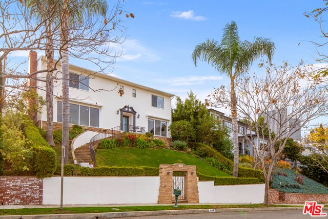 Located in this renowned Beverly Hills location is a Grand 2 story Traditional with views of the Hills. Perfect center hall floor plan has 4 bedrooms and 3.5 baths, a formal living room and a family room, kitchen, breakfast area and formal dining. Master has views, spa tub, walk-in closet. Beautiful hardwood floors throughout. Separate maids quarters off the kitchen and laundry room and a detached 1 Bd + 1 bath guest house. 2 car direct access garage from back street level, Dual zone A/C, Security system, Solar power and a pool/spa on a Street-to-Street lot on a quiet cul-de-sac.