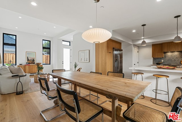 Incredible newly constructed architectural townhome in the heart of everything Santa Monica has to offer! Completed in 2021, this light-infused modern retreat beautifully blends indoor/outdoor living. //About this home: Exceptionally designed, this 2 Bedroom/2.5 Bath home offers a spacious floorplan and is drenched in natural light. Finished with an earth-toned, organic palette that exudes sophistication and warmth. Enter the main, open living space that offers an 11' ceiling, white oak flooring, and picturesque windows. Designer lighting throughout and a fabulous gourmet kitchen featuring Bosch stainless steel appliances, Quartzite counters, and a stunning Tilebar backsplash. A perfectly situated, well-sized private outdoor patio is an extension of your living space and is ideal for entertaining! Upstairs enjoy two spacious bedrooms, including your light and airy primary retreat with voluminous ceilings and ample closet space. Luxurious bathrooms are finished with Kohler fixtures, Bedrosian's wall tile, and in-shower skylights in the primary bathroom. A spacious laundry room adds the perfect convienence. //You'll Love: Your private roof deck! Enjoy the sunrises, sunsets, and ocean breezes! //The Neighborhood: Across the street from Virginia Ave Park, enjoy endless opportunities to play and enjoy the outdoors. Only 1.5 miles to the beach, a short walk to the Expo Line, the Pico Branch Library, the Farmers Market, 365 Wholefoods, and minutes to restaurants and shops on Ocean Park. This is SoCal living at its finest and an opportunity that will not last long!