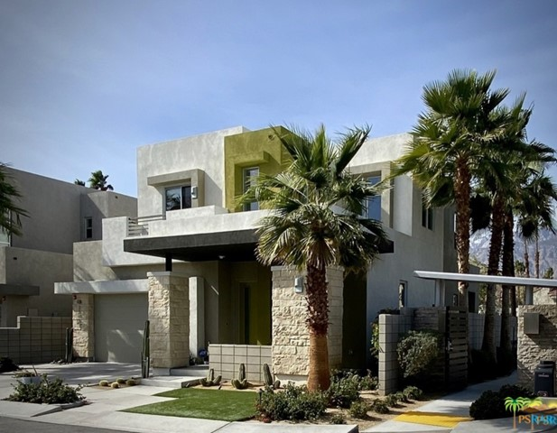 If you've been waiting for the perfect modern desert home that has it all ? Look no further. This stunning formal model home has been completely re-imagined and updated to reflect the latest in design trends and style. Paid for phase one solar means you'll rarely if ever have an energy bill. Finished oversized 2-car garage with AC mini split and epoxy concrete await your arrival. Upon entering, you will enter a desert oasis replete with stunning San Jacinto Mountain views from every window, spacious and private corner lot location with built-in BBQ and fire pit for cool autumn evenings. Brand-new designer porcelain flooring in the latest color themes compliment the high-end fixtures of the award-winning architecture of this modern desert residence.