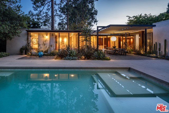 Sophisticated mid-century modern nestled in private and guard-gated enclave of Hidden Valley Estates. Dramatic courtyard entry welcomes one into the Rowan Residence by Robert Skinner (originally photographed in 1964 by Julius Shulman and featured in Taschen's Modernism Rediscovered). The meticulous restoration, led by architect John Bertram with designer Sarah Shetter, is in harmony with the original design, and incorporates Douglas fir furniture-grade custom cabinetry, terrazzo flooring, Calacatta Gold and Salt Marble countertops, LSI museum-quality lighting, redwood tongue and groove interior and exterior siding, all new fixtures, finishes and systems, and chef's kitchen with top-of-the-line appliances. Warm and elegant reimagining of the kitchen, primary suite, and office, with stylishly redone bathrooms and closets throughout the house. Carefully delineated personal spaces offer intimacy and privacy, set off from open floor plan common spaces. Walls of glass throughout create the ideal setting for indoor/outdoor living and entertaining. Beautiful pool, lush greenery, mature trees and gardens designed by Judy Kameon of Elysian Landscapes complete a relaxing and serene atmosphere in a verdant setting. This is a unique opportunity to live in an architectural work of art. Perfect for those seeking an exceptional and private lifestyle.