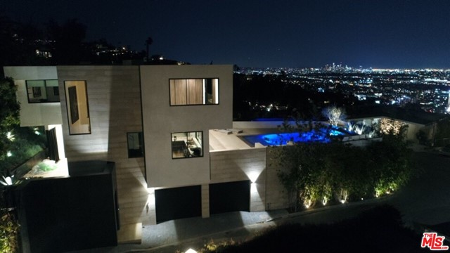 Perched high above the Sunset Strip in the Hollywood Hills, this 3-bedroom home is an entertainer's paradise. Designed by renowned architect Austin Kelly of XTEN Architecture, the modern gem offers supreme privacy & unobstructed 270-degree bird's-eye vistas. Limestone & black absolute granite walls, built-in seating areas & expansive walls of glass were used by Charles Infante to give the home a warm & contemporary feel. Beautifully furnished w/plush rugs, custom Italian closets, bespoke furniture & a state-of-the-art audio/visual system controllable from an iPhone. The home merges luxurious design w/once-in-a-lifetime functionality for a uniquely Californian experience. Outside, a dazzling zero-edge pool & entertaining space overlooks the cityscape below. The home is located just minutes from Soho House, The Edition, Franklin Canyon & all the entertainment in Hollywood & Beverly Hills. The buyer will appreciate its uniqueness, architecture & will certainly treasure the view.