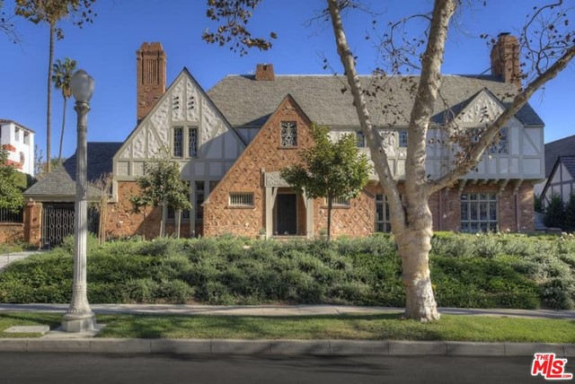 Stunning restored Classic English Tudor Estate by architect L.G. Scherer overlooking the golf course. Former home of Francis Ford Coppola and other Hollywood legends. Recent restoration by Tichnor & Thorpe with great attention to detail and original architectural elements. Dramatic 2 sty entry hall w/split staircase, large formal living rm with stenciled wood coffered ceilings, carved fireplace & stained glass. Wood paneled sunroom overlooking the gardens. Beautiful library w/fireplace Formal dining rm w/ original wood details. New gourmet kitchen/fam rm w/center island, custom cabinetry & marble slabs. French doors open to gardens & outdoor dining terraces. Master wing w/ large sitting room, dbl baths, high ceilings, fireplace, awning covered terrace & wonderful views. 3 additional family bdrms, one with large view terrace. Significant new gardens w/specimen trees, redesigned pool area and more.