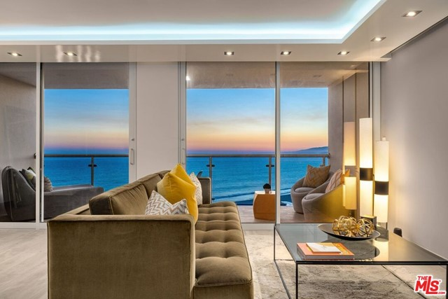 Absolutely stunning and move in ready just bring your toothbrush.  Enter in to a large open living room that opens to a sensational balcony with unobstructed ocean views...from the front door you feel as though you could step on to the sand.  Perfect for entertaining.  Ultra modern renovations of this unit in this full - service building.  Walk in and fall in love.