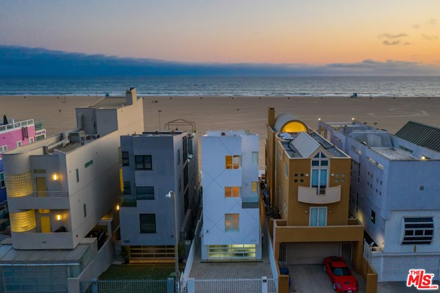 Extraordinary oceanfront architectural gem situated perfectly along the Santa Monica coastline. This modern masterpiece features 180 degree sweeping ocean and coastline views that include sand, surf, boardwalk, famed Santa Monica Pier and Ferris wheel, and Catalina Island. High-end design throughout includes walls of glass, floating staircase and glass elevator. Gourmet kitchen features top of the line appliances. Multiple decks throughout and an amazing roof-top patio. Perfect house for entertaining or kicking back solo and capturing world class sunsets from nearly all rooms. Unbeatable location with immediate access to Ocean Avenue, Third Street Promenade, Santa Monica Place, Farmers market, and more.