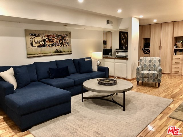 Located right above the Sunset Strip at the end of a cul-de-sac, this cozy, contemporary condo with only one common wall has so much to offer! This extra large 1bd/1ba unit has a spacious living room with fireplace and wet bar. Wood floors and recessed lighting throughout. Separate den/office space. Updated kitchen with custom, self-closing cabinets, gas stove and granite countertops. Bathroom offers separate walk-in shower and spa tub. Large walk-in closet in bedroom with custom built organizers. Central air & heat, washer/dryer in unit, lots of storage space! Building amenities include newly remodeled pool, spa, sauna, rec room, roof deck with city views and guest parking.
