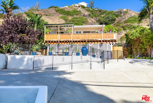 Wonderful turnkey Ocean View home with a rental unit! Must see. Mountain views and Ocean breezes surround tranquil property with 4 multi level decks for capturing the Malibu experience.  Upstairs main house: 3 bedroom/2 bath, or 2 bed with den/office.  Master has private entry/exit with patio lounge area, walk in closet, Mr. Steam Spa shower. Abundant natural light in all rooms, wood flooring throughout, open kitchen, granite counters, wrap around deck with endless views. Lower Level: 1 Bed, 1 Bath separate living quarters/income unit. Short walk to beach, shops, restaurants, park. 20 min to downtown Santa Monica. Multi family zone per City of Malibu. Check with City to confirm zoning for full list of allowable uses.